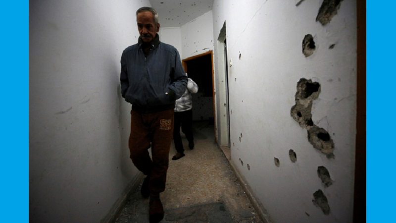 Man walks in a damaged house where a Palestinian gunman was killed by Israeli forces near Nablus in the Israeli-occupied West Bank 1.jpg